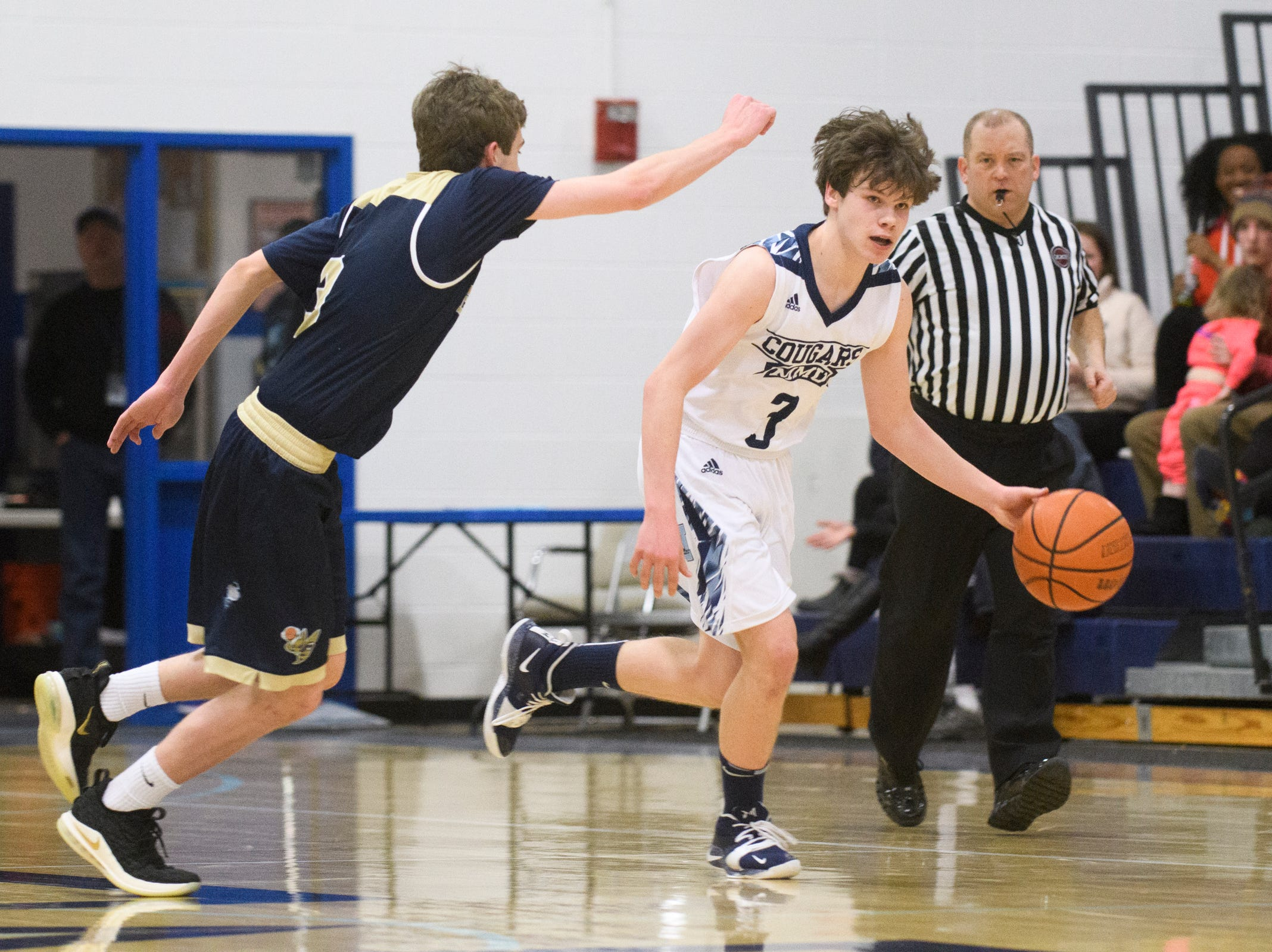 MMU's Justin Morse (3) dribbles the ball down the court past Essex's Brendan Brooks (3) during the boys basketball game between the Essex Hornets and the Mount Mansfield Cougars at MMU High School on Wednesday night February 13, 2019 in Jericho, Vermont.