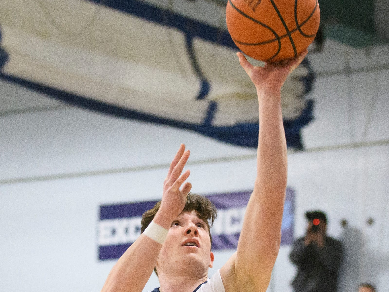 MMU's Mike Dix (14) leaps for a lay up during the boys basketball game between the Essex Hornets and the Mount Mansfield Cougars at MMU High School on Wednesday night February 13, 2019 in Jericho, Vermont.