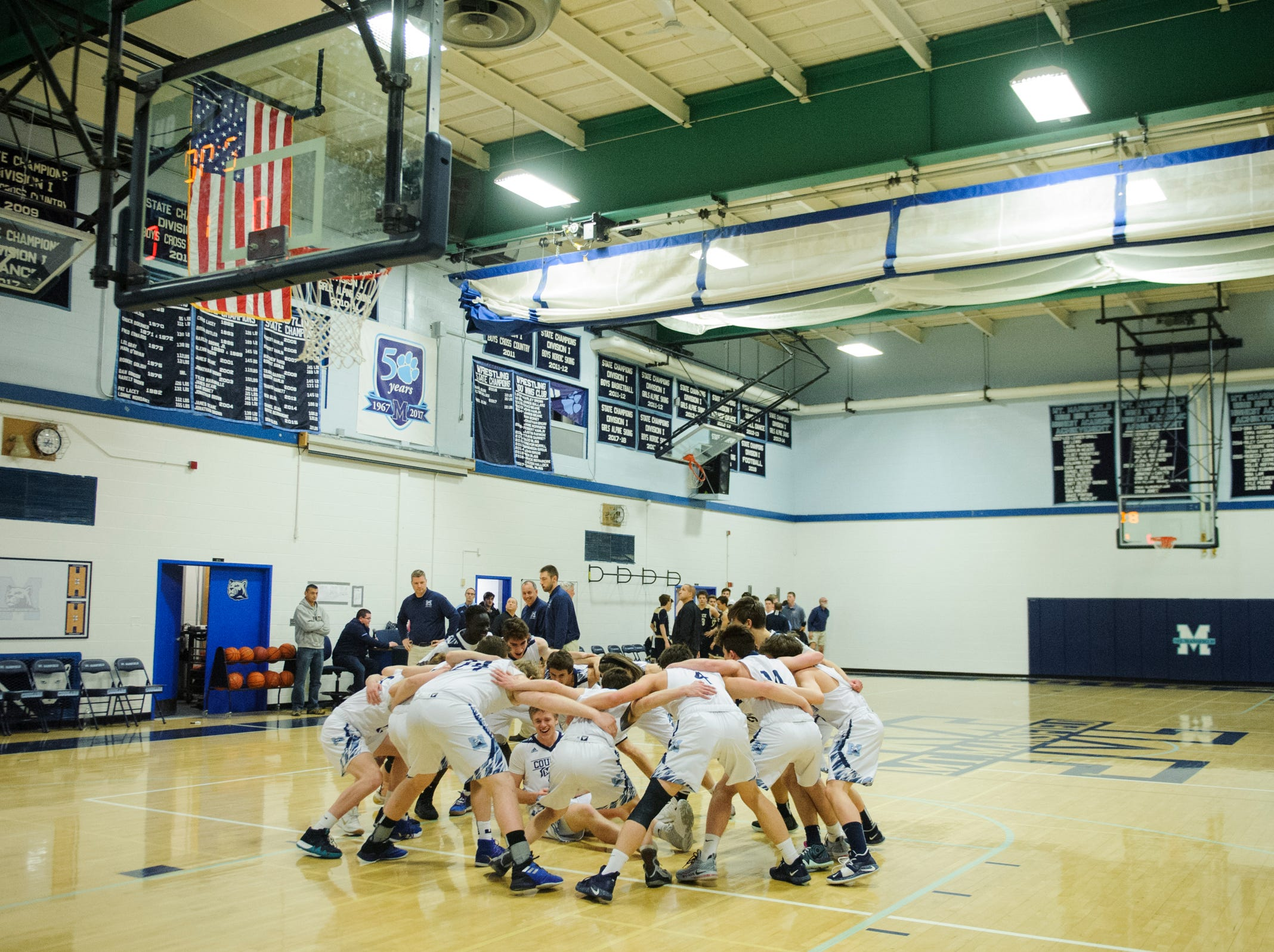 MMU huddles together during the boys basketball game between the Essex Hornets and the Mount Mansfield Cougars at MMU High School on Wednesday night February 13, 2019 in Jericho, Vermont.