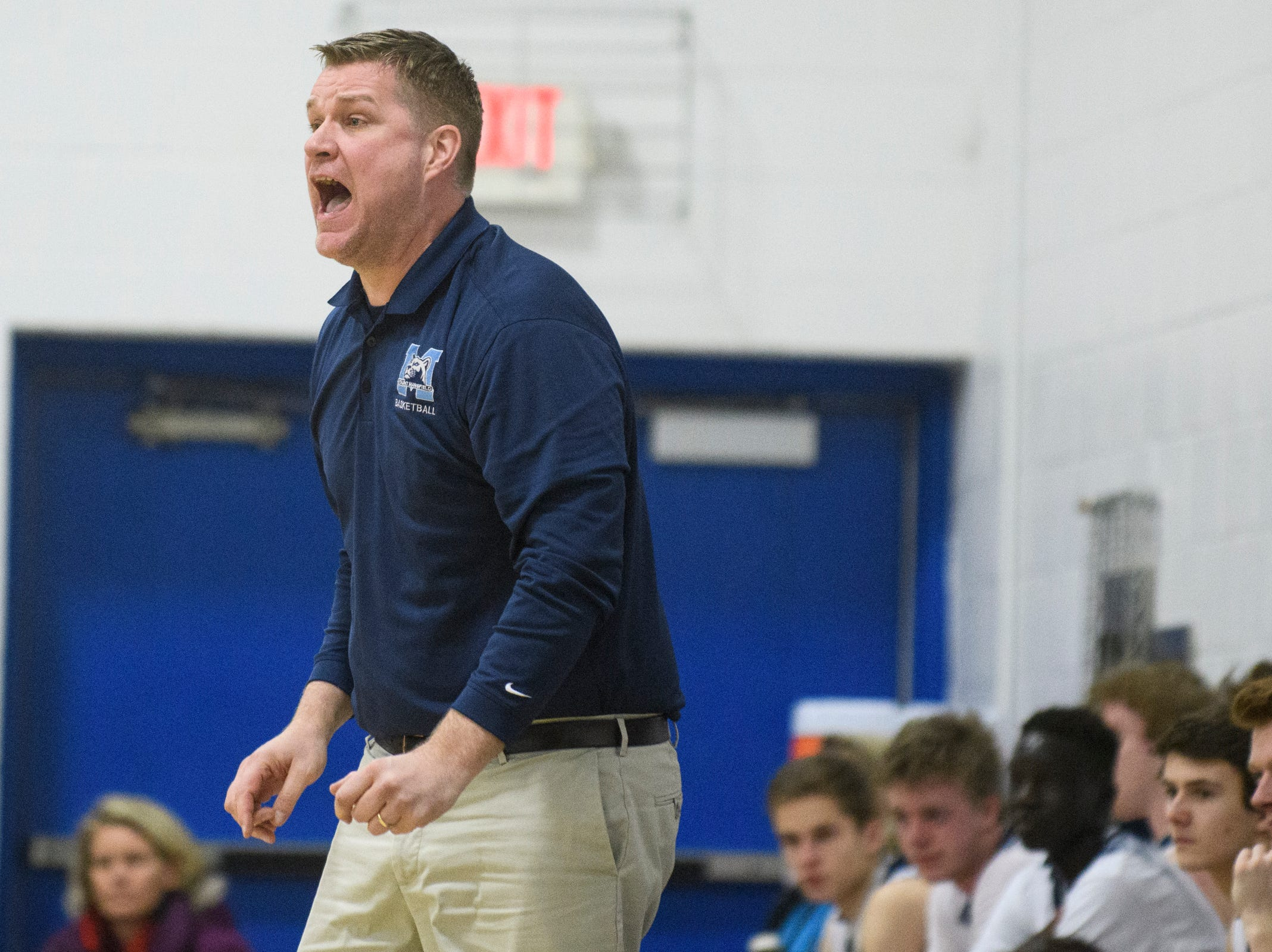 MMU head coach Jeff Davis talks to the team on the court during the boys basketball game between the Essex Hornets and the Mount Mansfield Cougars at MMU High School on Wednesday night February 13, 2019 in Jericho, Vermont.