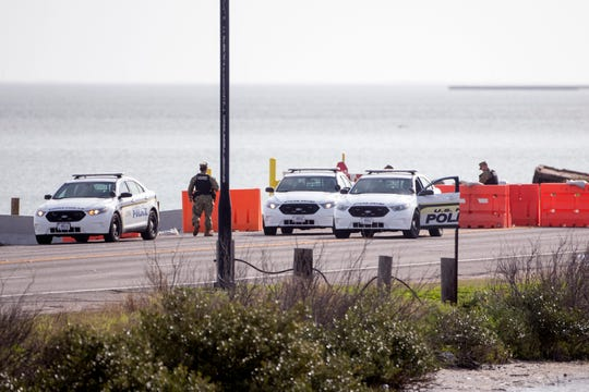 A man was fatally shot after military officials say he drove through a gate early Thursday, February 14, 2019, at Naval Air Station-Corpus Christi, and sped away before crashing into a barrier. The North gate at the base, which is behind these barriers on Ocean Drive will be closed to traffic until all further notice.