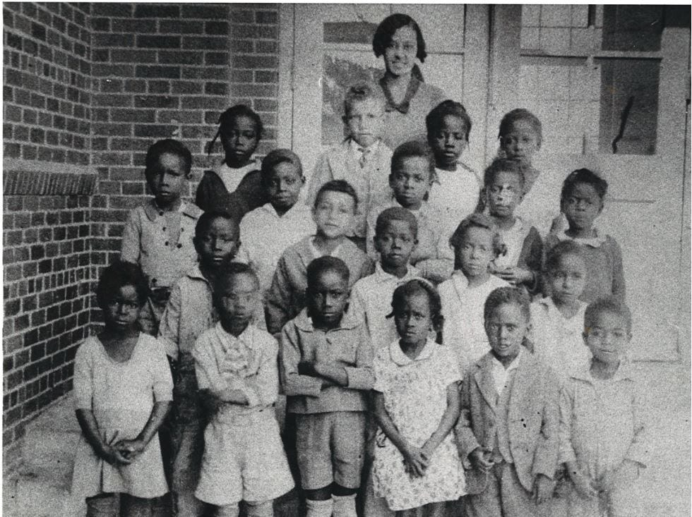 In this 1930 photo, students of Solomon Coles Elementary School pose for a class photo.