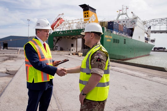 Port of Corpus Christi Harbormaster Russell Cordo welcomes British Army Cap. Terry Bickerstaff as soldiers with Britain's 3rd United Kingdom Division offload equipment for a months-long exercise at Fort Hood.