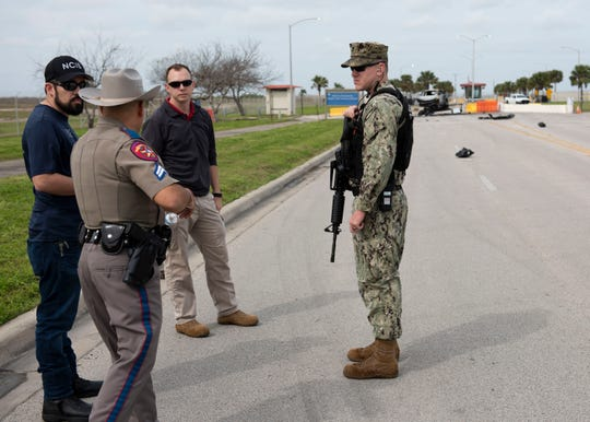 U.S. Navy Security Forces, Naval Criminal Investigative Services, and Texas Department of Public Safety survey the crash scene after a vehicle unlawfully entered Naval Air Station Corpus Christi, Feb. 14. Navy Security Forces personnel opened fire after the suspect crashed his vehicle into a barrier and charged Security Forces personnel. No personnel were injured during the incident and emergency services pronounced the suspect deceased on the scene. Contributed photo/U.S. Navy/Anne Owens
