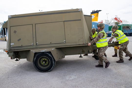 Soldiers from Britain's 3rd United Kingdom Division prepare to offload equipment from a vessel at the Port of Corpus Christi on Thursday, February 14, 2019, that will be used during months of Army training at Fort Hood.