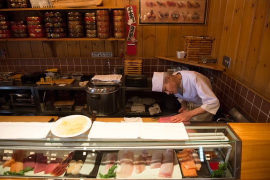 Owner Shigeru Fukuyoshi works behind the sushi bar Wednesday, Feb. 13, 2019 at Sagami in Collingswood, N.J.