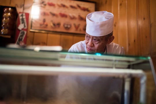 Shigeru Fukuyoshi prepares for dinner service at his restaurant Sagami Wednesday, Feb. 13, 2019 in Collingswood, N.J.