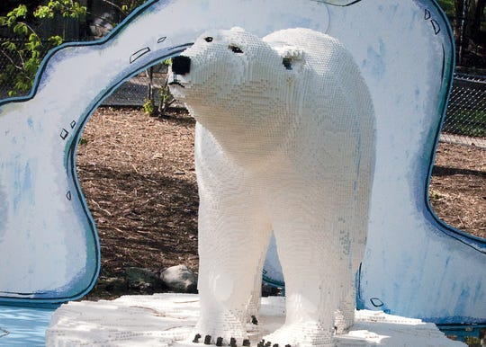 Hundreds of Lego form this polar bear as part of the 'Creatures of Habitat' exhibit coming to the Philadelphia Zoo.