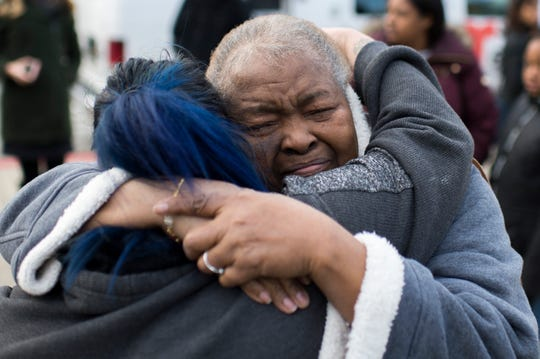 The victim's grandmother, right, who declined to provide her same, is hugged following a press conference held by police Thursday, Feb. 14, 2019 in Camden, N.J. Nerreada Robles, 17, was struck and killed by a Camden police cruiser the night before.