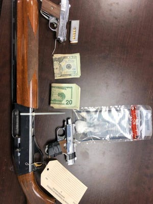 Cash, guns, and suspected methamphetamine were seized during a search of a home on Ohio 41 in Bainbridge on Wednesday, Feb. 14, 2019.