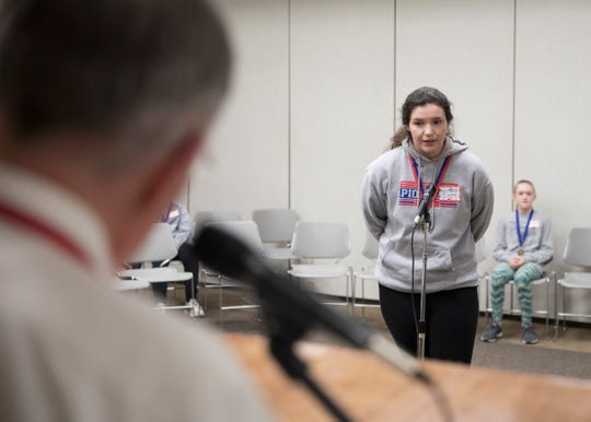 "Zane Trace eighth-grader Macy Long spells the words ""ballerina"" and ""vulcanize"" to take first place at the 2019 Ross County Spelling Bee Thursday afternoon in Chillicothe."