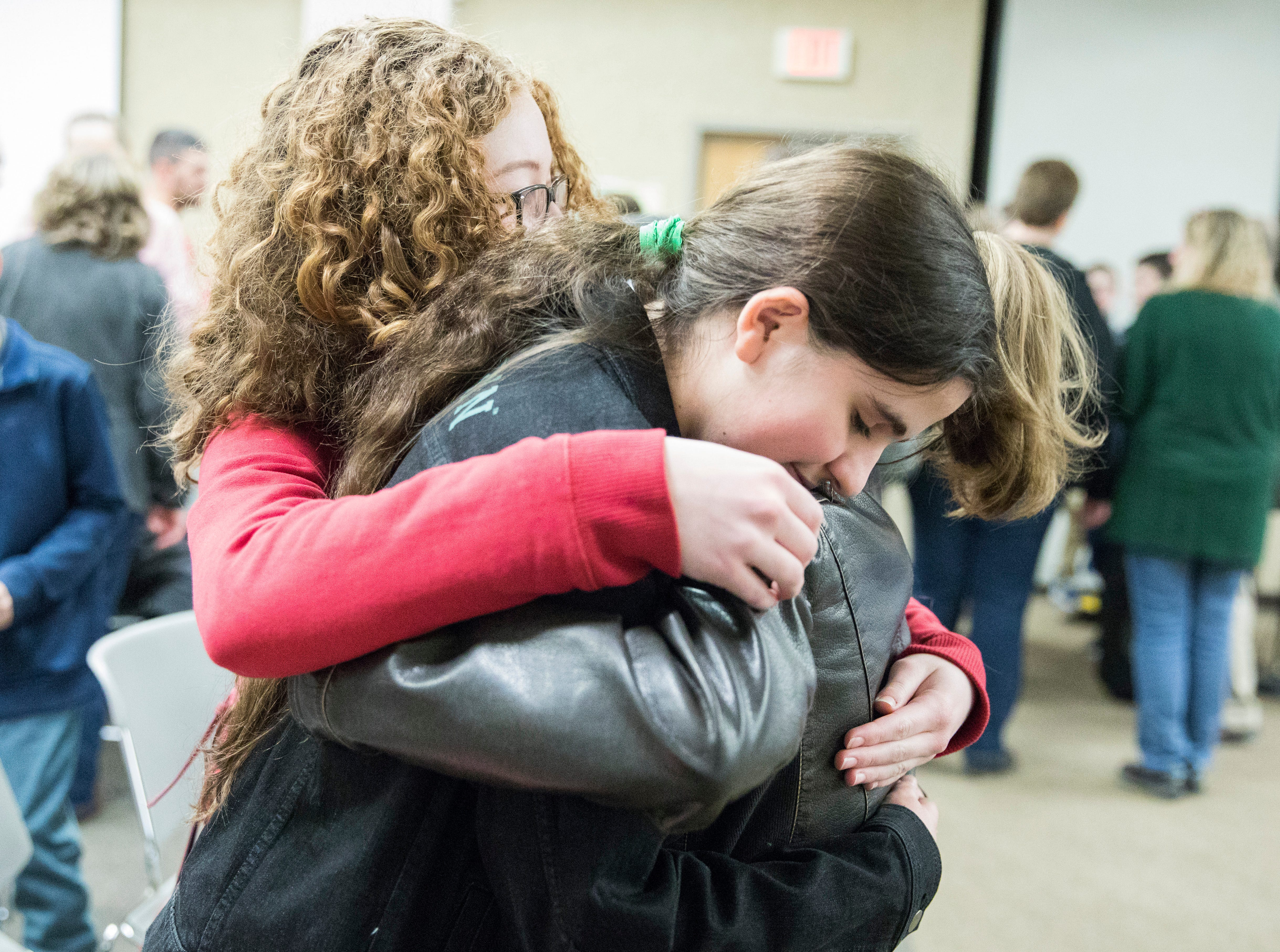 Southeastern eighth-grader Tali Pinhas is congratulated by her best friends Avery Hartshorn and Savannah Fout even though Pinhas did not place in the top three of the 2019 Ross County Spelling Bee Thursday afternoon in Chillicothe.