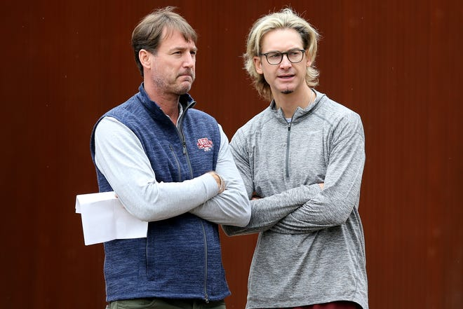 Cincinnati Reds President of Baseball Operations Dick Williams, left, talks with former Cincinnati Reds pitcher Bronson Arroyo as pitchers and catchers work out, Thursday, Feb. 14, 2019, at the Cincinnati Reds spring training facility in Goodyear, Arizona.
