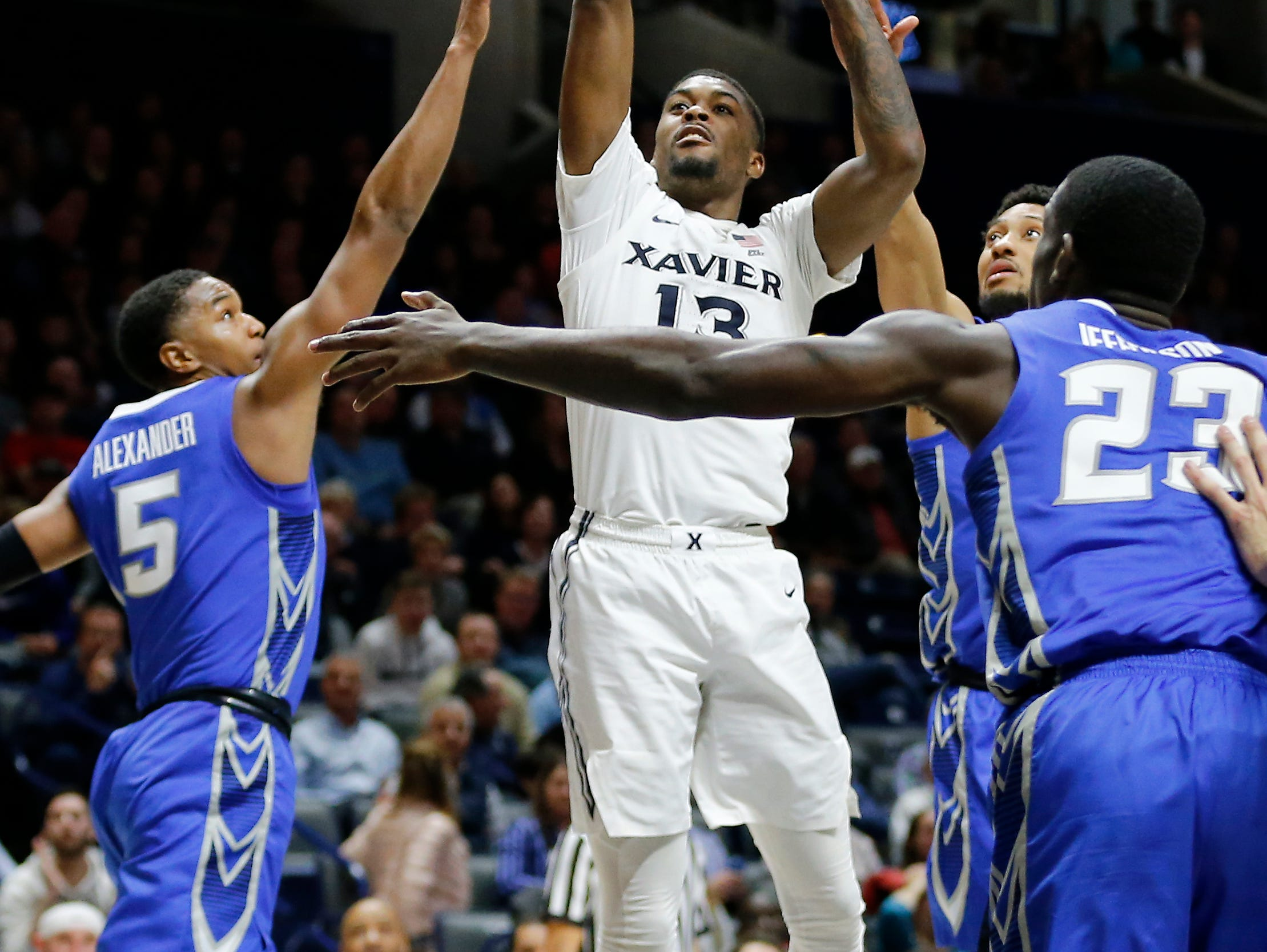 Xavier Musketeers forward Naji Marshall (13) shoots a short shot in the second half of the NCAA Big East Conference basketball game between the Xavier Musketeers and the Creighton Bluejays at Xavier's Cintas Center in Cincinnati on Thursday, Feb. 14, 2019. Xavier broke a 6-game losing streak with a 64-61 overtime win over Creighton.