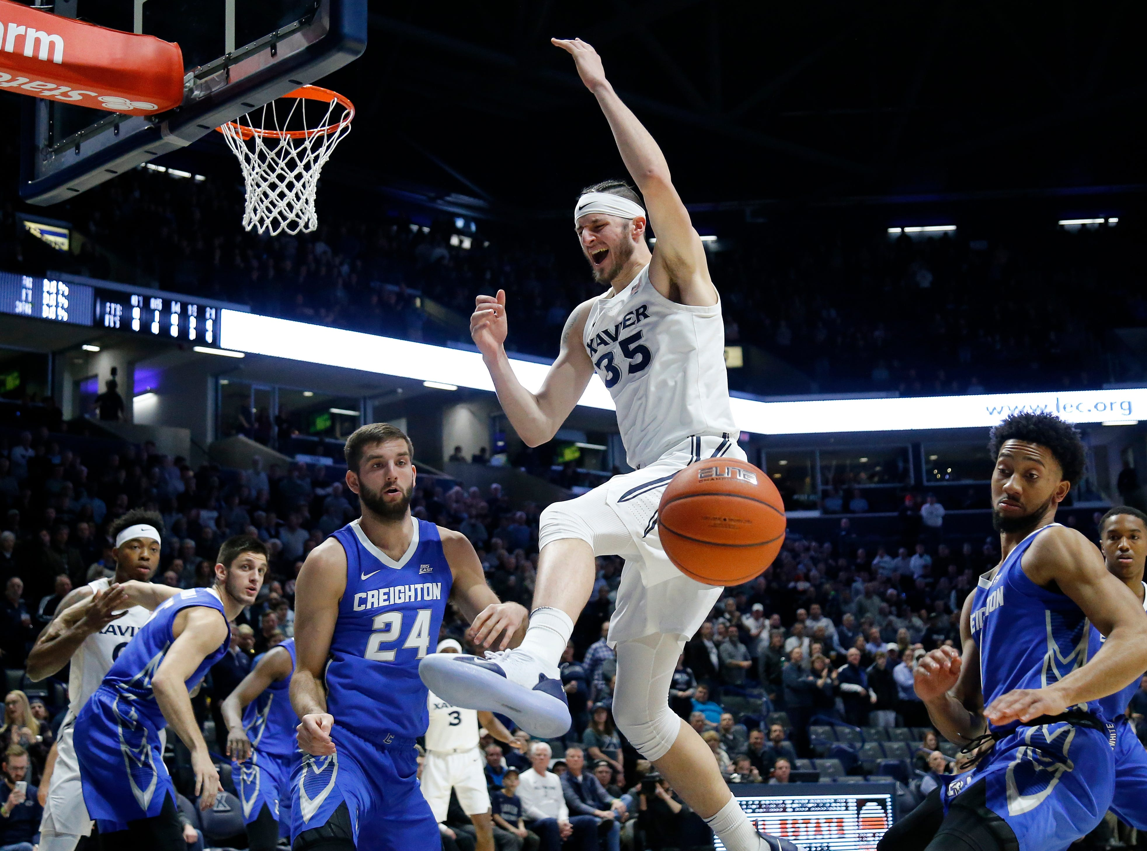 Xavier Musketeers forward Zach Hankins (35) reacts after being fouled chasing a rebound in the first half of the NCAA Big East Conference basketball game between the Xavier Musketeers and the Creighton Bluejays at Xavier's Cintas Center in Cincinnati on Wednesday, Feb. 13, 2019. Xavier led 36-30 at halftime.