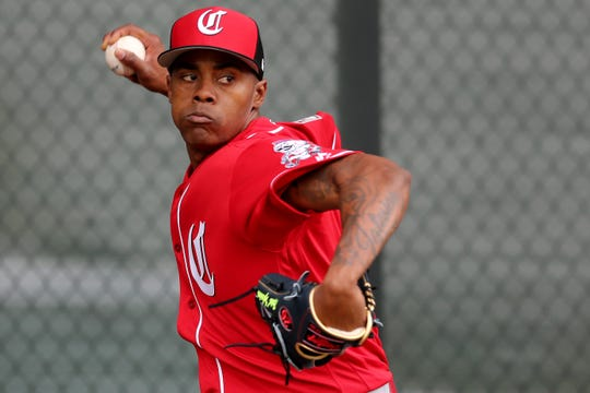 Cincinnati Reds relief pitcher Raisel Iglesias (26) delivers during a bullpen session, Thursday, Feb. 14, 2019, at the Cincinnati Reds spring training facility in Goodyear, Arizona.