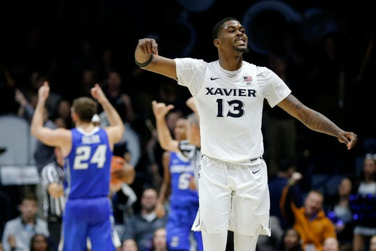 Xavier Musketeers forward Naji Marshall (13) celebrates after Xavier holds the tie-game with 4.4 seconds remaining in the second half of the NCAA Big East Conference basketball game between the Xavier Musketeers and the Creighton Bluejays at Xavier's Cintas Center in Cincinnati on Thursday, Feb. 14, 2019. Xavier broke a 6-game losing streak with a 64-61 overtime win over Creighton.