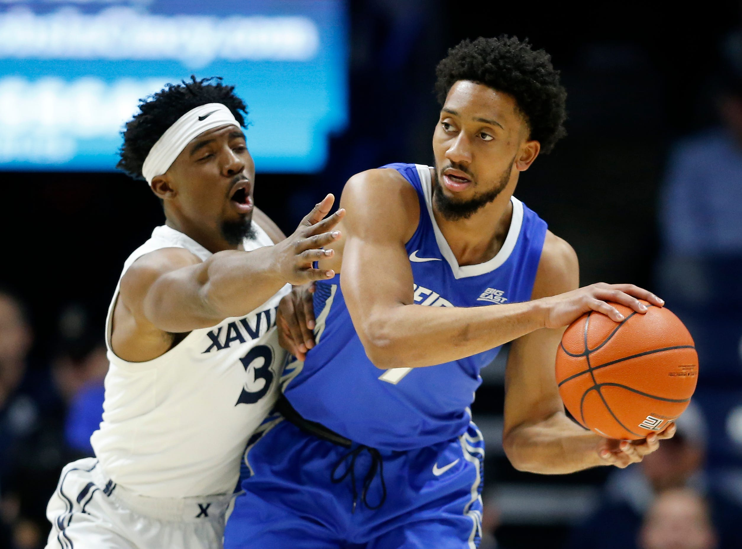 Xavier Musketeers guard Quentin Goodin (3) guards Creighton Bluejays guard Davion Mintz (1) in the first half of the NCAA Big East Conference basketball game between the Xavier Musketeers and the Creighton Bluejays at Xavier's Cintas Center in Cincinnati on Wednesday, Feb. 13, 2019. Xavier led 36-30 at halftime.