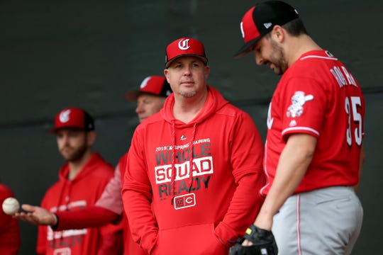 Cincinnati Reds pitching coach Derek Johnson (36) talks with Cincinnati Reds pitcher Tanner Roark (35) during a bullpen session, Thursday, Feb. 14, 2019, at the Cincinnati Reds spring training facility in Goodyear, Arizona.