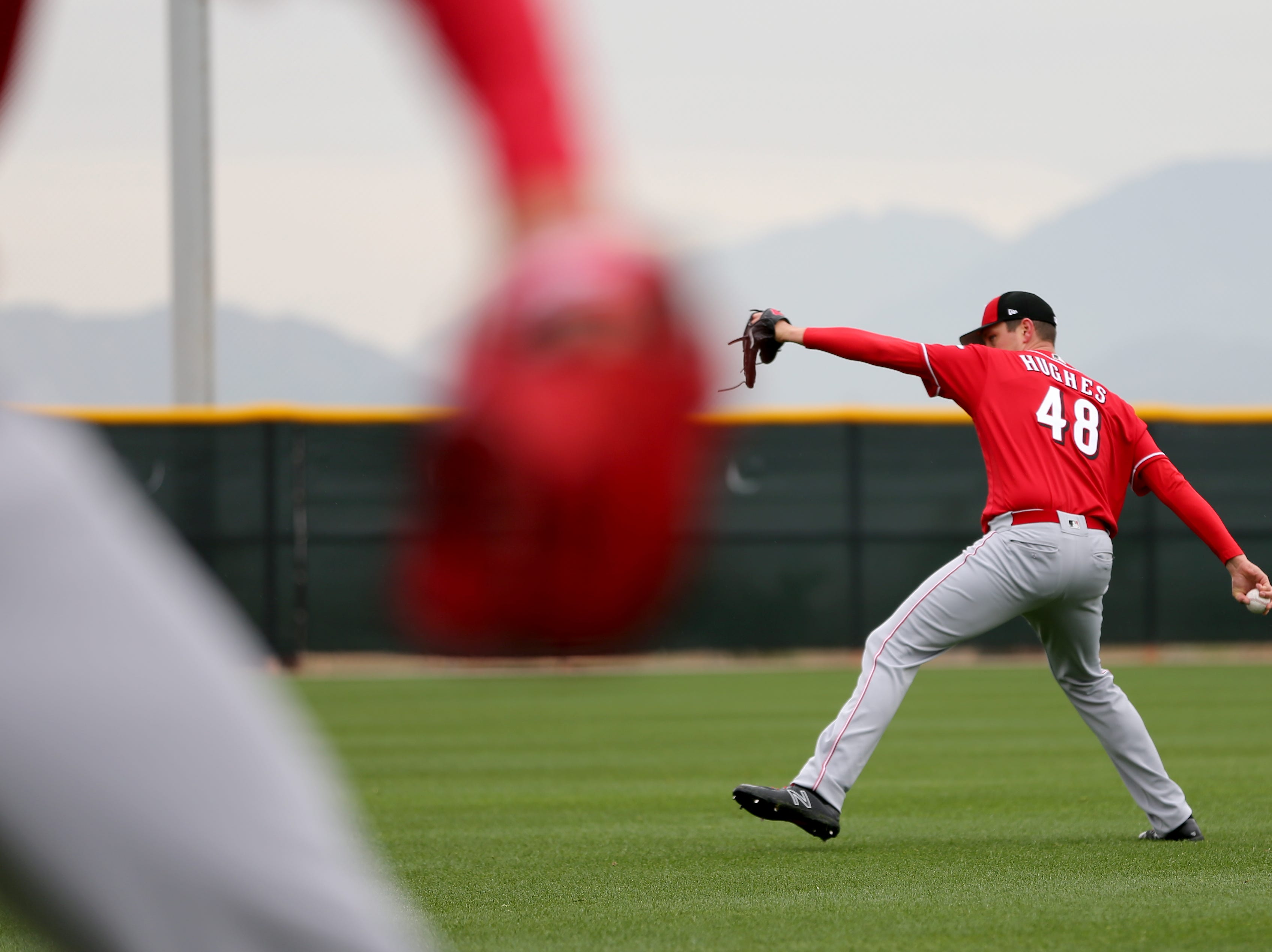 Cincinnati Reds relief pitcher Jared Hughes (48) throws during long-toss drills as pitchers and catchers work out, Thursday, Feb. 14, 2019, at the Cincinnati Reds spring training facility in Goodyear, Arizona.