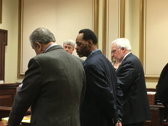 Thomas Walker, his hands shackled behind his back, stands between his attorneys, Perry Ancona, at left, and Norm Aubin, at right, for his sentencing Thursday in Hamilton County Common Pleas Court.