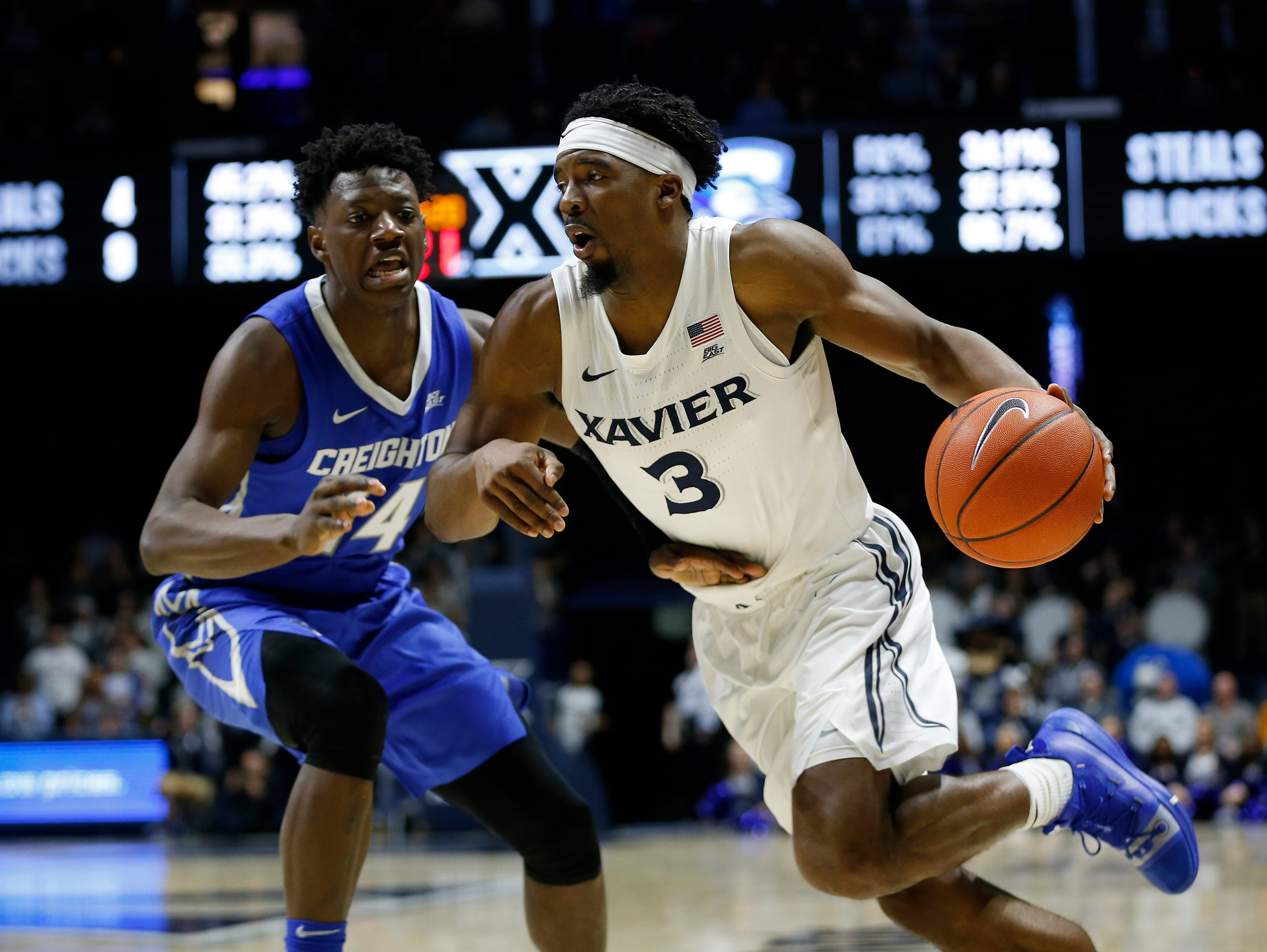 Xavier Musketeers guard Quentin Goodin (3) drives against Creighton Bluejays guard Kaleb Alejandro Joseph (14) in the second half of the NCAA Big East Conference basketball game between the Xavier Musketeers and the Creighton Bluejays at Xavier's Cintas Center in Cincinnati on Wednesday, Feb. 13, 2019. Xavier broke a 6-game losing streak with a 64-61 overtime win over Creighton.
