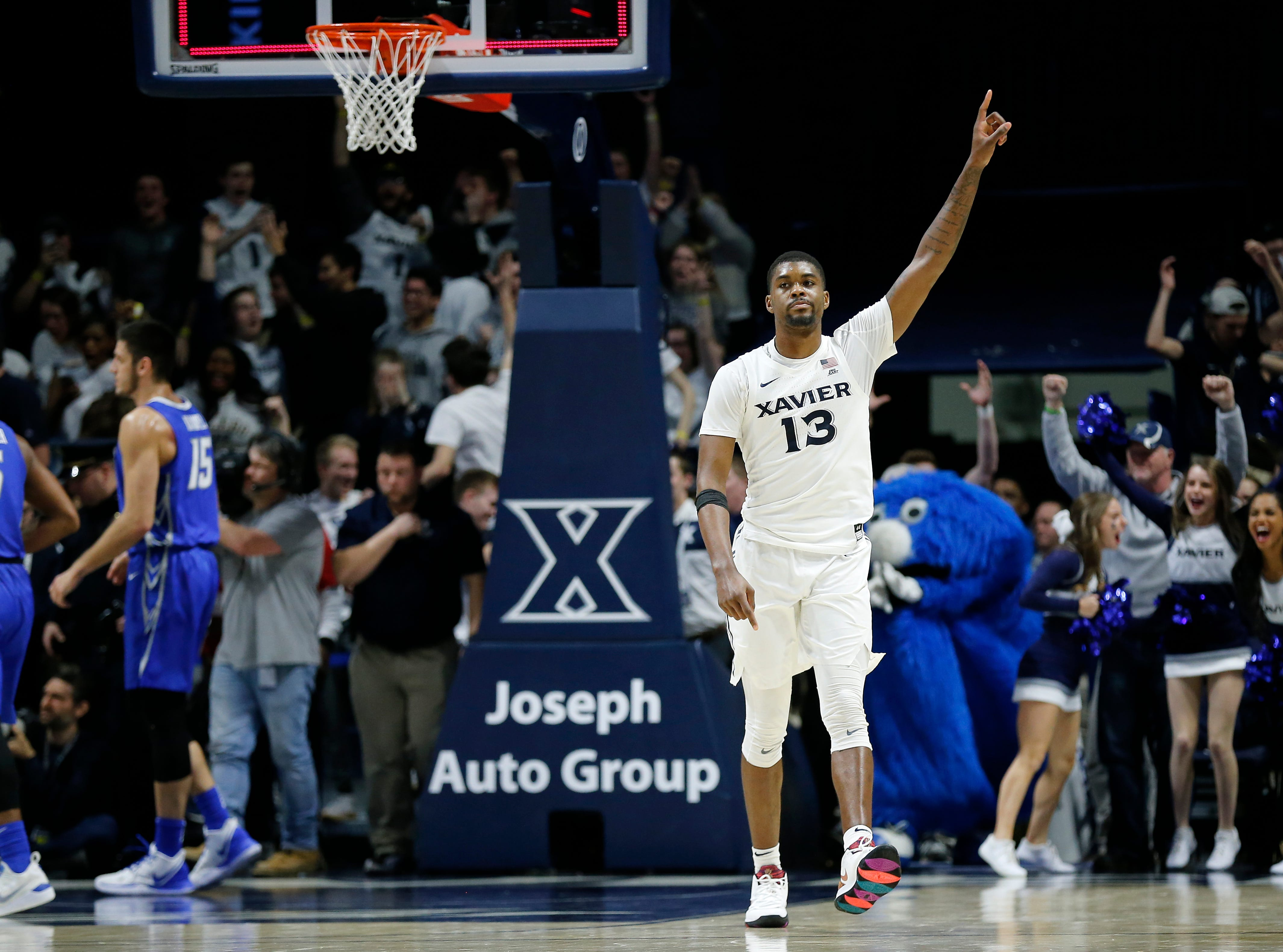 Xavier Musketeers forward Naji Marshall (13) celebrates at the final buzzer of overtime in the NCAA Big East Conference basketball game between the Xavier Musketeers and the Creighton Bluejays at Xavier's Cintas Center in Cincinnati on Thursday, Feb. 14, 2019. Xavier broke a 6-game losing streak with a 64-61 overtime win over Creighton.