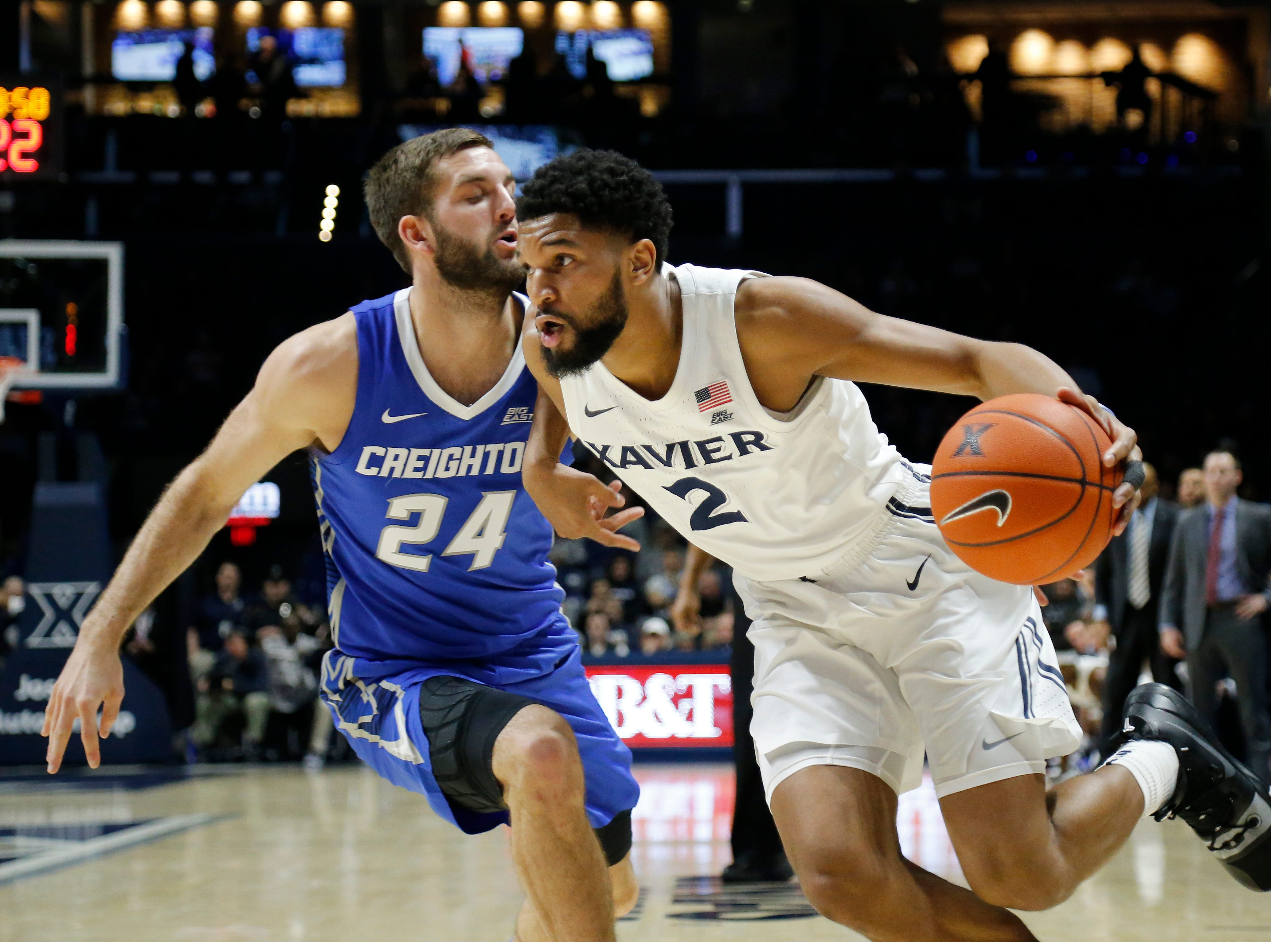 Xavier Musketeers guard Kyle Castlin (2) drives along the baseline against Creighton Bluejays guard Mitch Ballock (24) in the first half of the NCAA Big East Conference basketball game between the Xavier Musketeers and the Creighton Bluejays at Xavier's Cintas Center in Cincinnati on Wednesday, Feb. 13, 2019. Xavier led 36-30 at halftime.