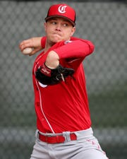 Cincinnati Reds starting pitcher Sonny Gray (54) delivers during a bullpen session, Thursday, Feb. 14, 2019, at the Cincinnati Reds spring training facility in Goodyear, Arizona.