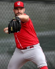 Cincinnati Reds pitcher Tanner Roark (35) delivers during a bullpen session, Thursday, Feb. 14, 2019, at the Cincinnati Reds spring training facility in Goodyear, Arizona.