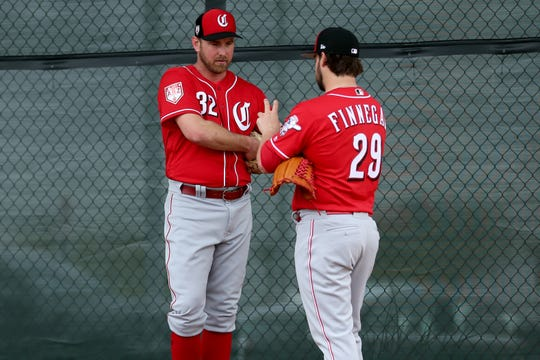 Cincinnati Reds relief pitcher Zach Duke (32) walks with pitcher Brandon Finnegan as pitchers and catchers work out, Thursday, Feb. 14, 2019, at the Cincinnati Reds spring training facility in Goodyear, Arizona.