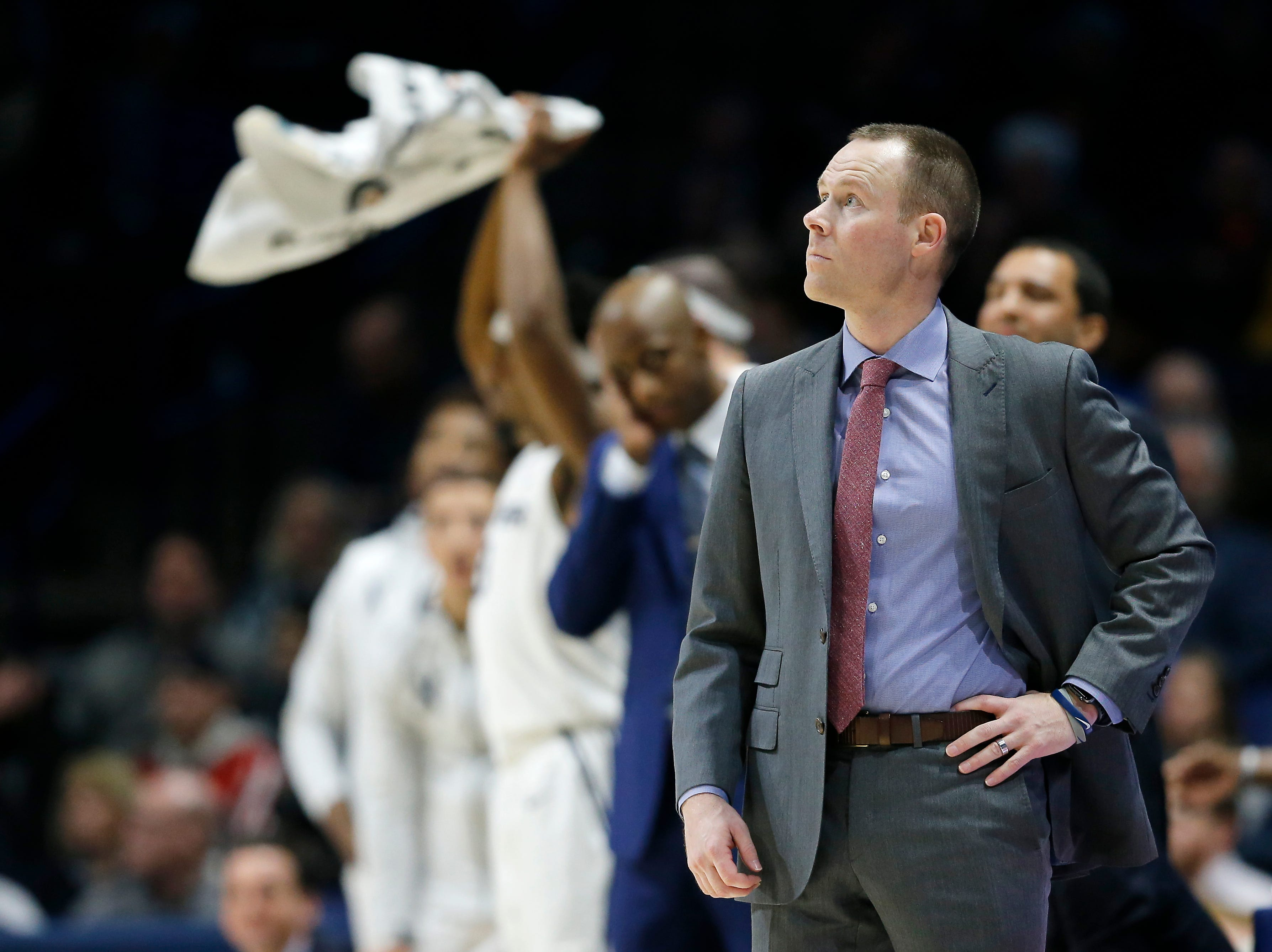 Xavier Musketeers head coach Travis Steele looks up to the big screen in the first half of the NCAA Big East Conference basketball game between the Xavier Musketeers and the Creighton Bluejays at Xavier's Cintas Center in Cincinnati on Wednesday, Feb. 13, 2019. Xavier led 36-30 at halftime.