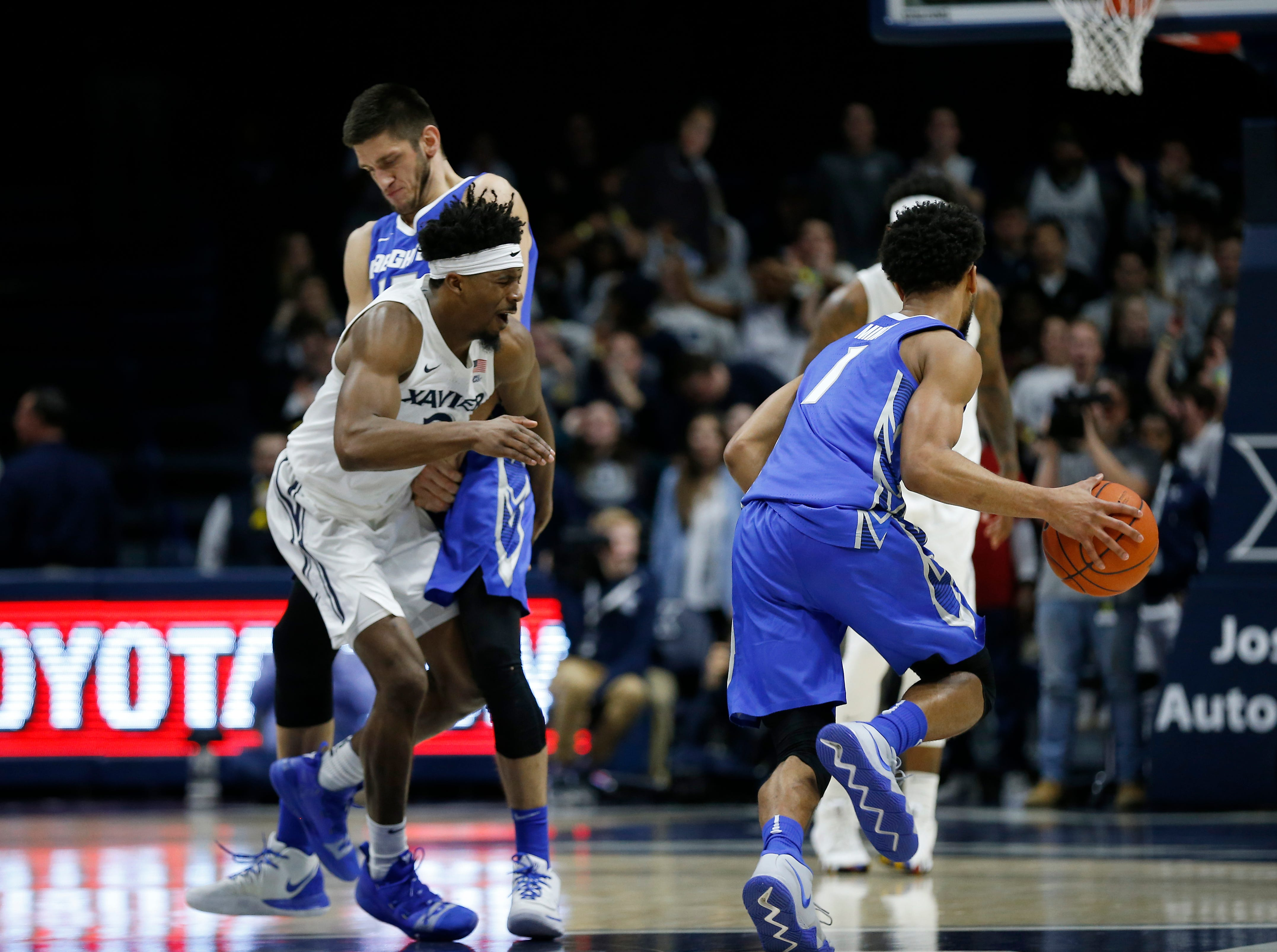 Xavier Musketeers guard Quentin Goodin (3) collides with a pick set by Creighton Bluejays forward Martin Krampelj (15) in the second half of the NCAA Big East Conference basketball game between the Xavier Musketeers and the Creighton Bluejays at Xavier's Cintas Center in Cincinnati on Thursday, Feb. 14, 2019. Xavier broke a 6-game losing streak with a 64-61 overtime win over Creighton.