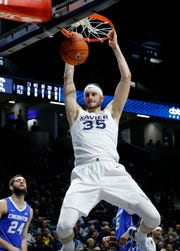 Xavier Musketeers forward Zach Hankins (35) throws down a dunk in the first half of the NCAA Big East Conference basketball game between the Xavier Musketeers and the Creighton Bluejays at Xavier's Cintas Center in Cincinnati on Wednesday, Feb. 13, 2019. Xavier led 36-30 at halftime.