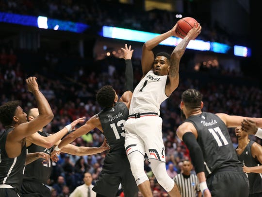 Jacob Evans' last game was UC's loss to Nevada in the second round of the NCAA Tournament. Cincinnati Bearcats guard Jacob Evans III (1) pulls down a rebound in the first half of the second-round South Region NCAA Tournament game between the Nevada Wolf Pack and the Cincinnati Bearcats, Sunday, March 18, 2018