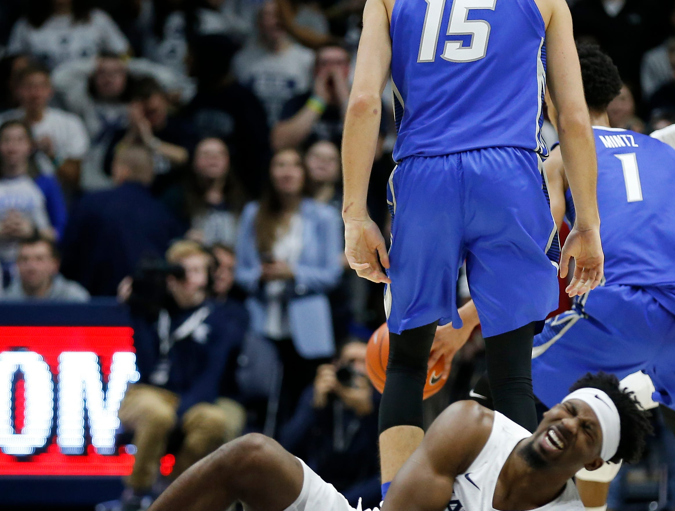 Xavier Musketeers guard Quentin Goodin (3) falls to the ground after colliding with a pick set by Creighton Bluejays forward Martin Krampelj (15) in the second half of the NCAA Big East Conference basketball game between the Xavier Musketeers and the Creighton Bluejays at Xavier's Cintas Center in Cincinnati on Thursday, Feb. 14, 2019. Xavier broke a 6-game losing streak with a 64-61 overtime win over Creighton.