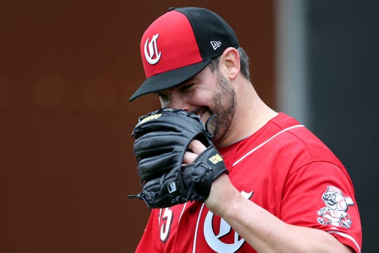 Cincinnati Reds pitcher Tanner Roark (35) smiles after a bullpen session, Thursday, Feb. 14, 2019, at the Cincinnati Reds spring training facility in Goodyear, Arizona.