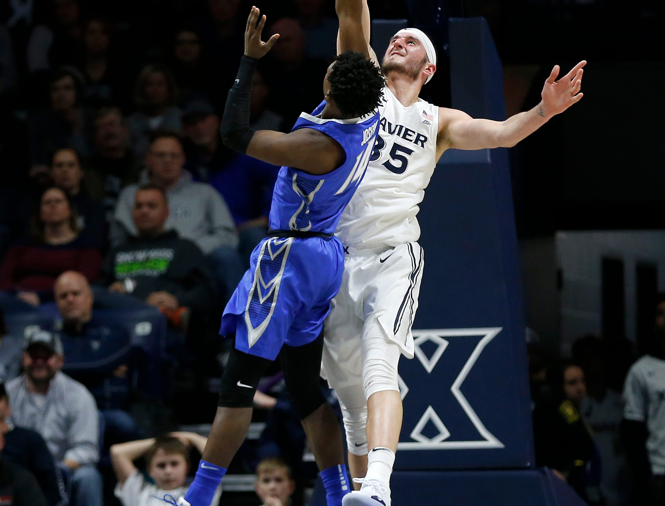 Xavier Musketeers forward Zach Hankins (35) rejects a shot by Creighton Bluejays guard Kaleb Alejandro Joseph (14) in the first half of the NCAA Big East Conference basketball game between the Xavier Musketeers and the Creighton Bluejays at Xavier's Cintas Center in Cincinnati on Wednesday, Feb. 13, 2019. Xavier led 36-30 at halftime.