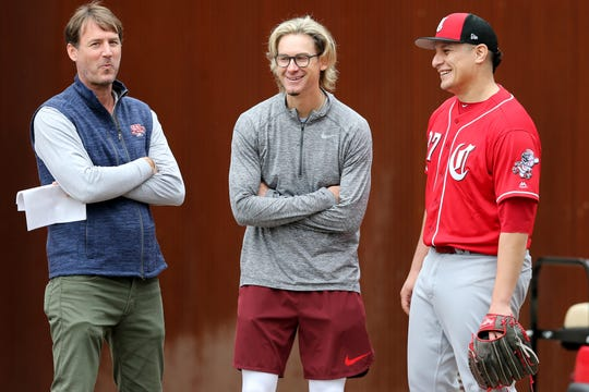 Cincinnati Reds President of Baseball Operations Dick Williams, former Cincinnati Reds pitcher Bronson Arroyo and Cincinnati Reds relief pitcher David Hernandez (37) share a laugh as pitchers and catchers work out, Thursday, Feb. 14, 2019, at the Cincinnati Reds spring training facility in Goodyear, Arizona.
