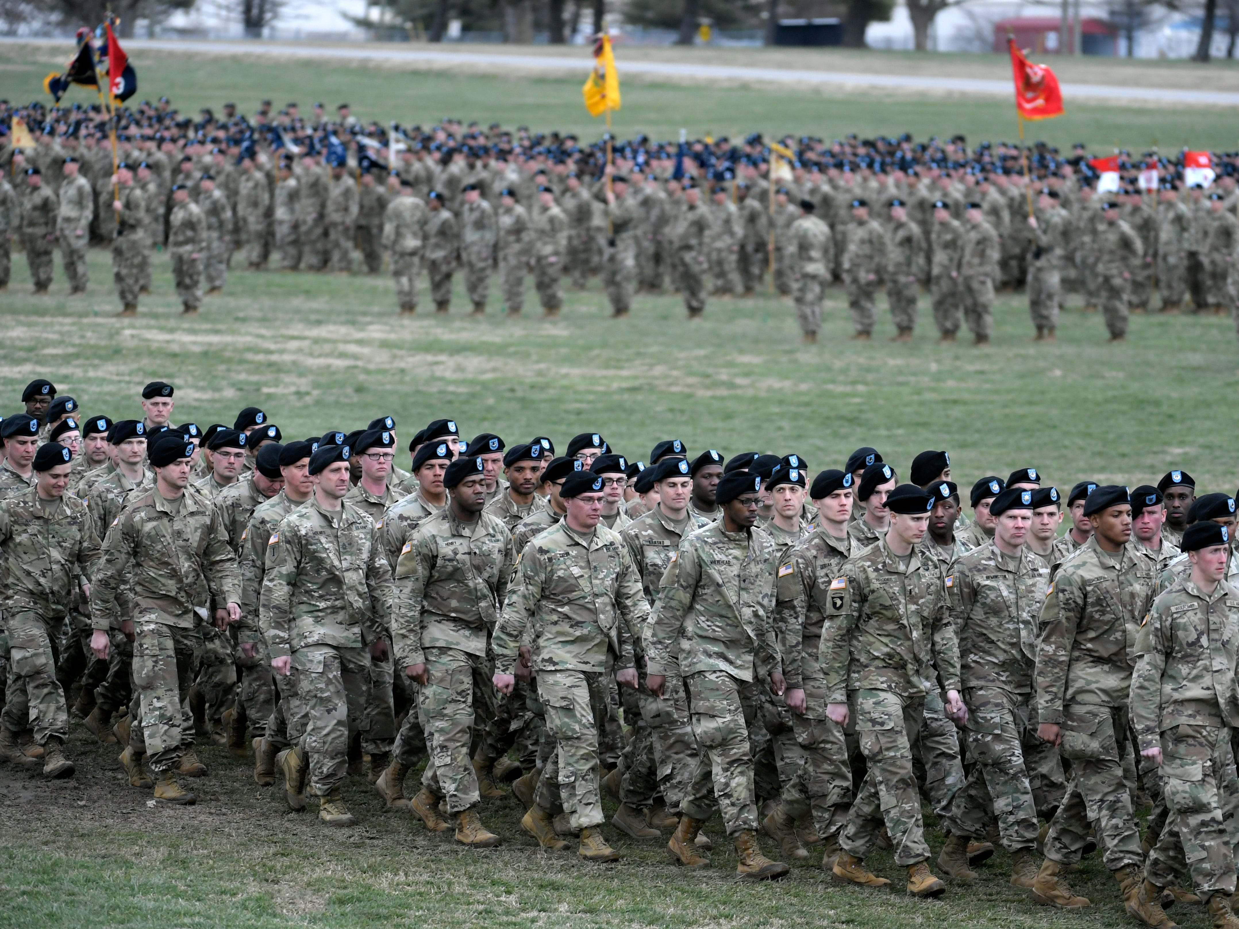 Troops march for a pass and review for Maj. Gen. Brian Winski during a 101st Airborne Division (Air Assault) and Fort Campbell Division Change of Command ceremony in Fort Campbell, KY on Thursday, Feb. 14, 2019.