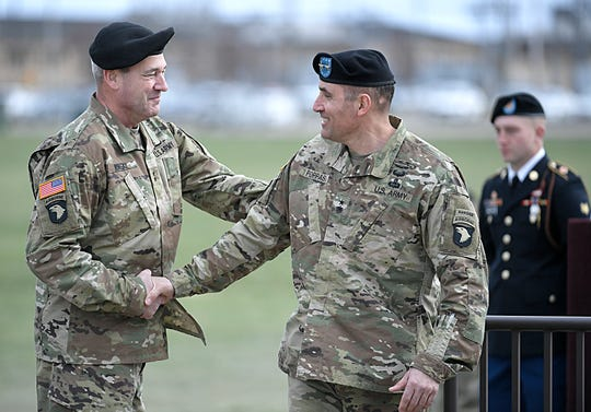 Maj. Gen. Brian Winski, left, shakes hands with Maj. Gen. Andrew Poppas during a 101st Airborne Division (Air Assault) and Fort Campbell Division Change of Command ceremony in Fort Campbell, KY on Thursday, Feb. 14, 2019.