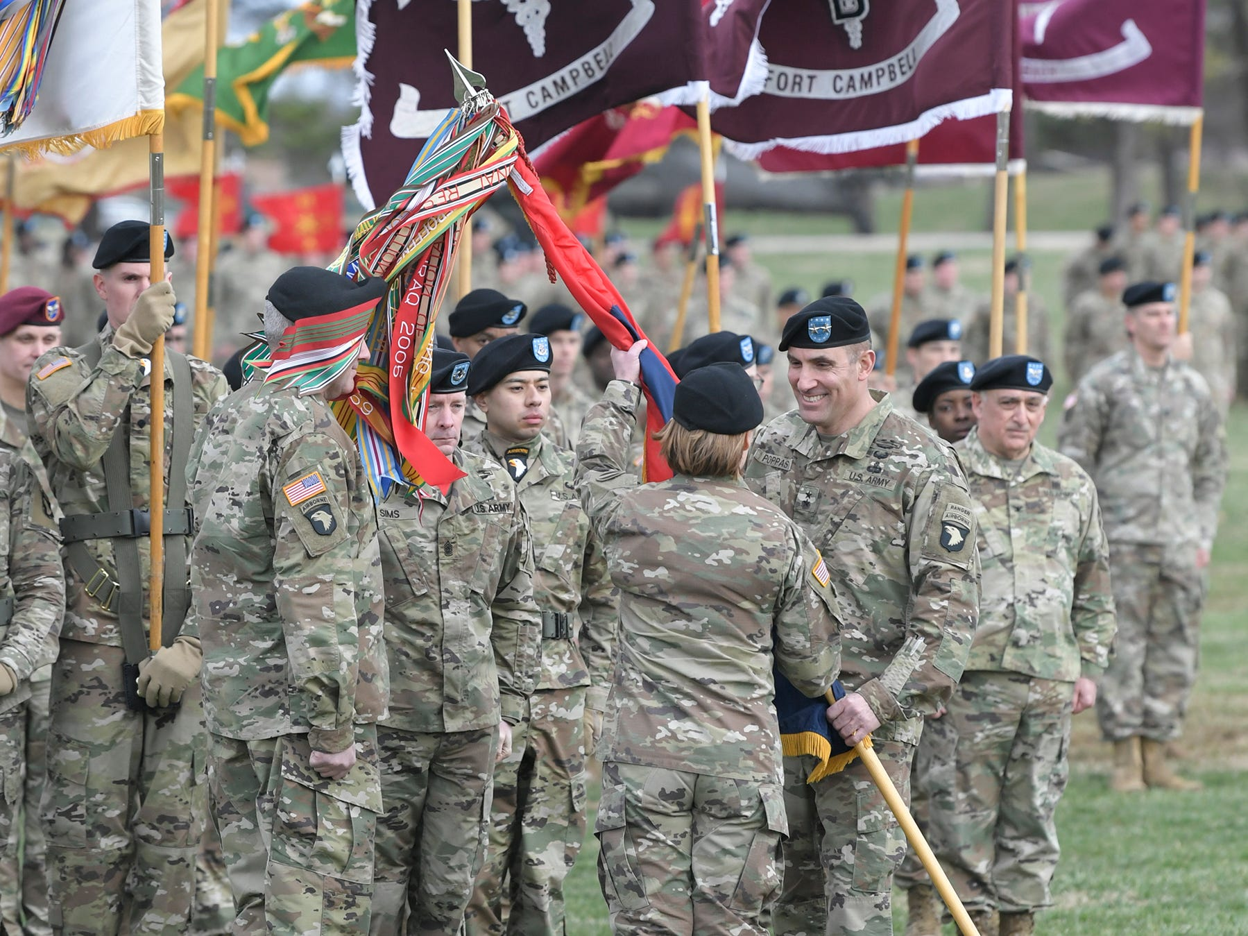 Maj. Gen. Andrew Poppas, right, relinquishes his command to Maj. Gen. Brian Winski, during a 101st Airborne Division (Air Assault) and Fort Campbell Division Change of Command ceremony in Fort Campbell, KY on Thursday, Feb. 14, 2019.