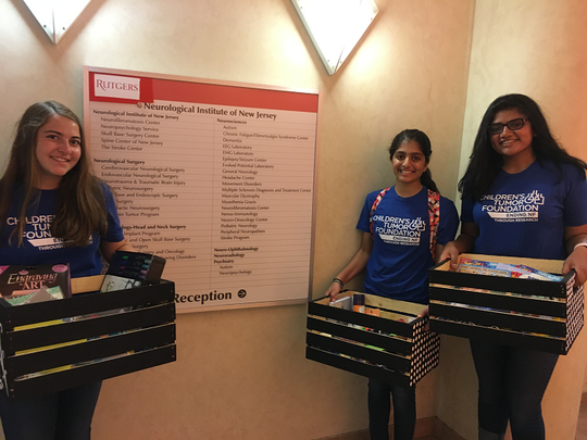 Left to right: Michelle Masiello of Hillsborough, Mira Amin of Bridgewater and Ritu Peddinti of Bridgewater deliver baskets as part of their community service project at NJMS.