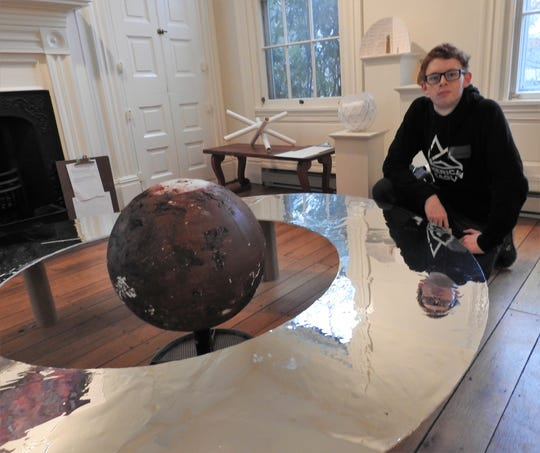 Justin Williams said a model he worked on for Mars was re-imagined as a concept for Saturn as part of the Imagine Planets project. Students of Coshocton High School came up with ideas that will be turned into scale models proportionally scattered across Coshocton County. The centerpiece will be a 19-foot diameter sun at the artPARK made by AK Steel.