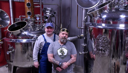 Rob Ashcraft and Larry Turner with the brewing equipment at Killbuck Creek Distillery in Warsaw. The distillery owners met while Ashcraft worked as a shift manager at a local business and Turner was a Columbus police officer.
