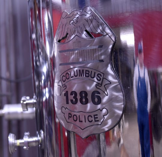 A recreation of Steve Smith's Columbus Police badge, number1386, on the side of equipment at Killbuck Creek Distillery in Warsaw.  Smith was killed in the line of duty in 2016 and the distillery named its 1386 Bourbon Whiskey in his honor.