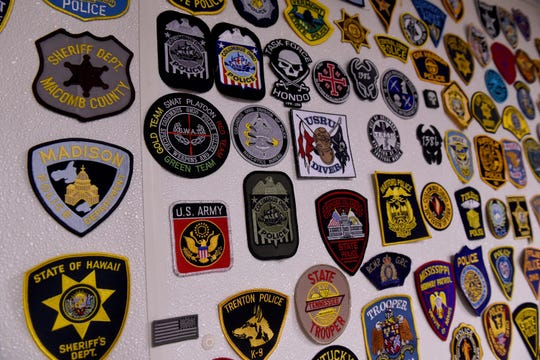 Collection of patches from law enforcement, first responders, and military from around the world at Killbuck Creek Distillery in Warsaw.
