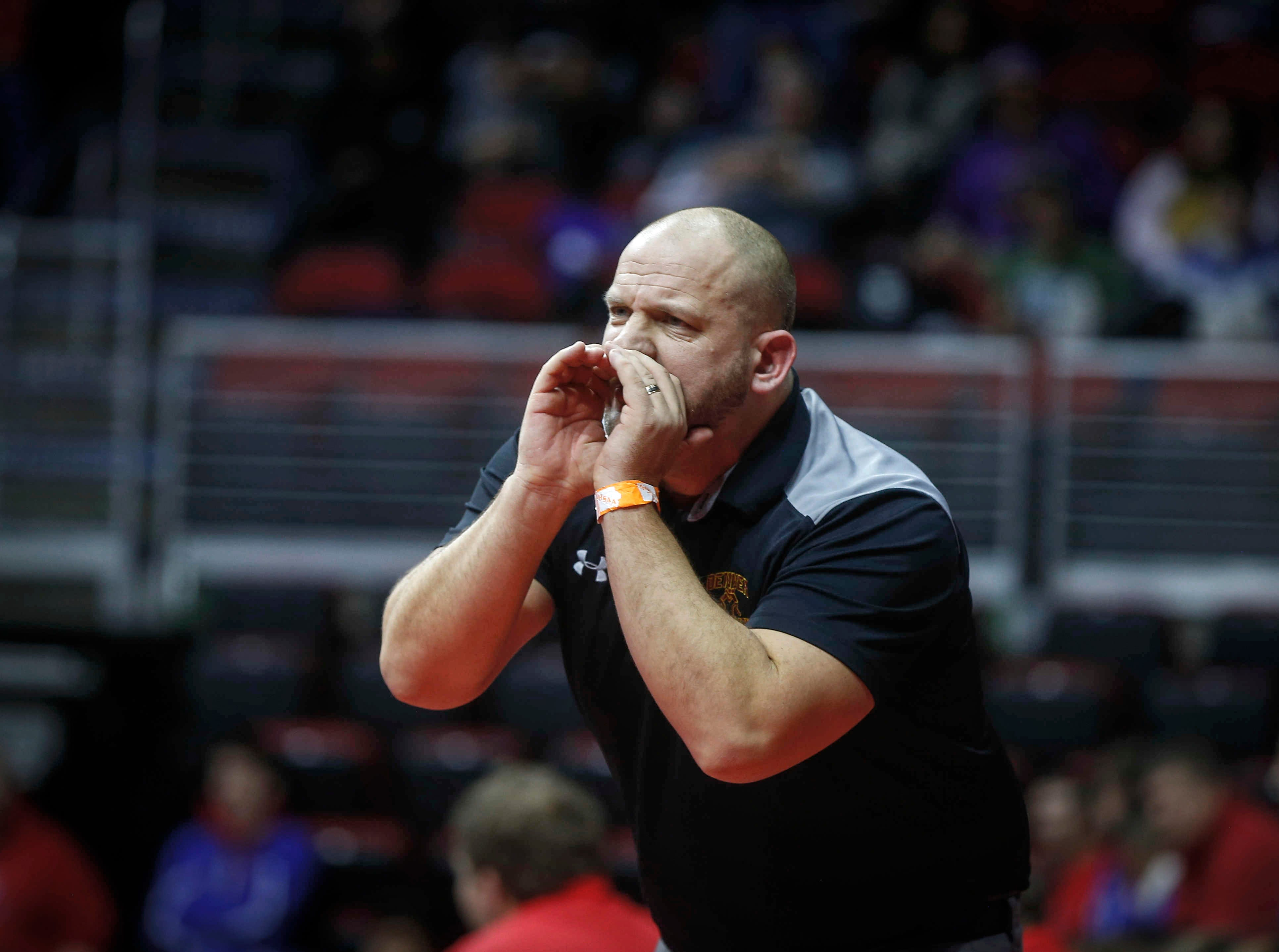 Denver head wrestling coach Chris Krueger calls out to a wrestler in a state dual against Don Bosco during the 2019 Iowa high school dual wrestling state tournament on Wednesday, Feb. 13, 2019, at Wells Fargo Arena in Des Moines.