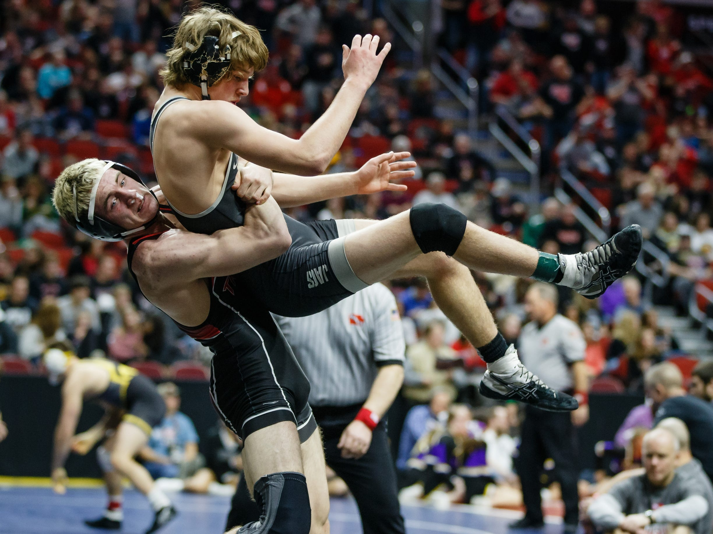 Dakota Southworth of Cedar Falls wrestles Logan Neils of Ankeny Centennial during their 3A 170 lb match at the state wrestling tournament on Thursday, Feb. 14, 2019 in Des Moines.