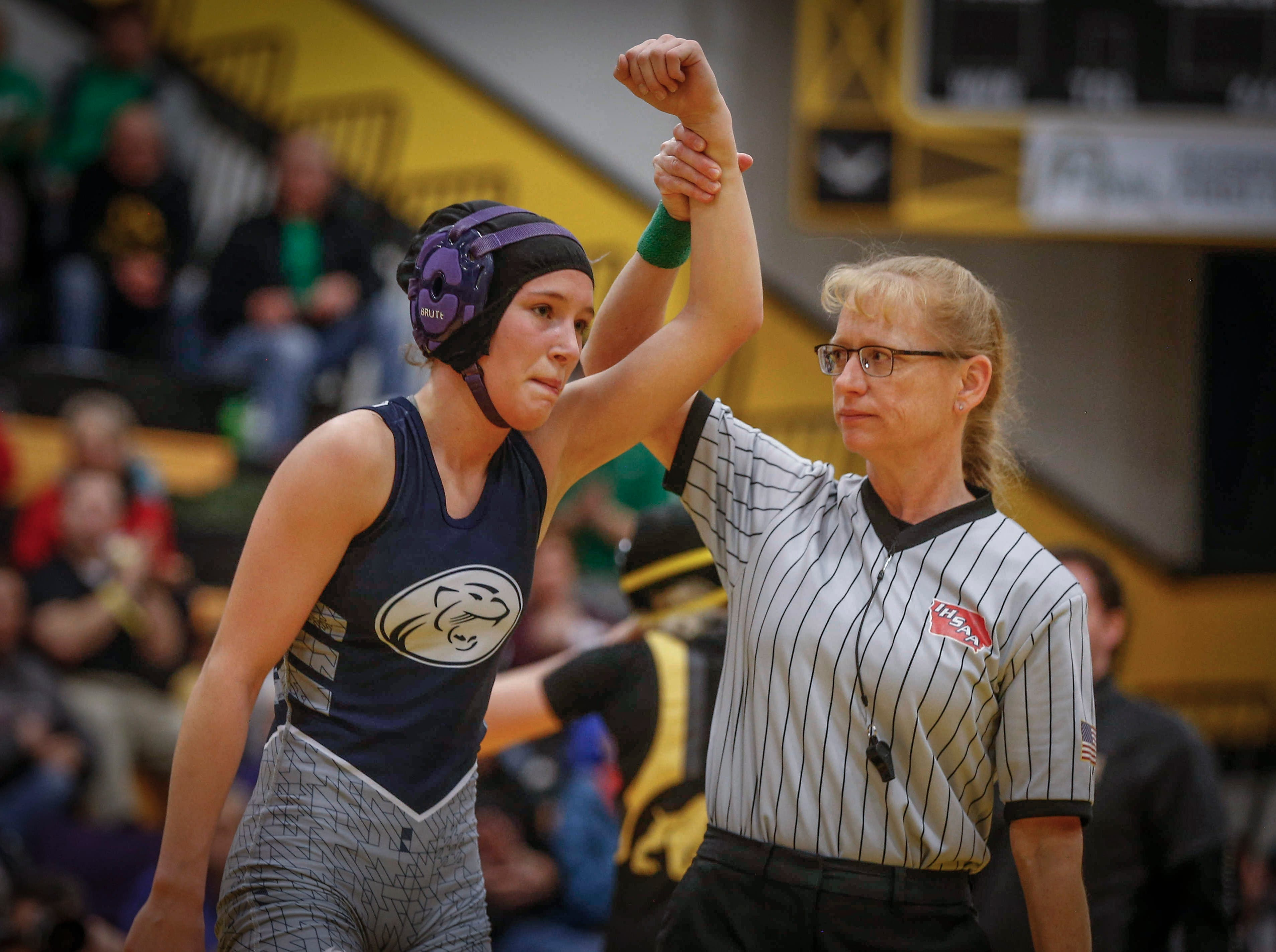 Wrestling official Nadine Ihde, shown at right in a file photo from the first ever Iowa high school girls state wrestling tournament, is the first female to ever officiate a state wrestling match.